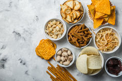Salty beer snacks in whit bowls Royalty Free Stock Images
