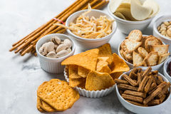 Salty beer snacks in whit bowls Stock Photo