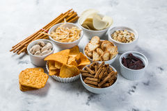 Salty beer snacks in whit bowls Stock Photography