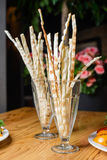 Salty bread snacks. Salty breadsticks in a glass on table royalty free stock image