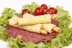 Salty cheese crackers with salami and tomatoes. On the lettuce Royalty Free Stock Photo
