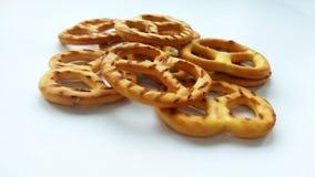 Salty cracker mini pretzels on white background royalty free stock photo
