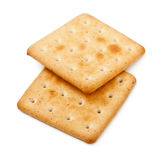 Salty Crackers. Two salty crackers isolated on white background Stock Images