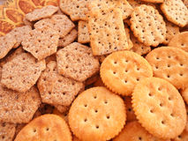 Salty Crackers. Plate full of a variety of crispy, salty crackers in different shapes and sizes Stock Images