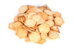 Salty crackers. Heap of salty crackers isolated on white background Stock Photos