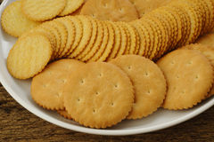 Salty crackers on plate Stock Image