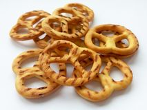 Salty crispy cracker mini pretzels on white background stock photo