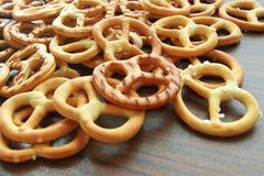 Salty crispy cracker mini pretzels on wooden table background royalty free stock photos