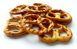 Salty crispy cracker pretzels on white background royalty free stock photography