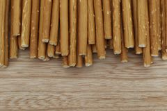Salty and crunchy stick crackers on wooden desk royalty free stock image