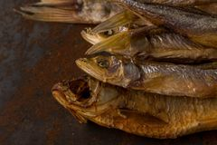 Salty dry river fish. Dried fish. Salty dry river fish on a rusty metal plate background Royalty Free Stock Photos