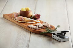 Salty fish assorti with potato on wooden plate Royalty Free Stock Images