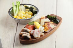 Salty fish assorti with potato on wooden plate Royalty Free Stock Photography