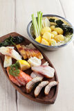 Salty fish assorti with potato on wooden plate Stock Photography