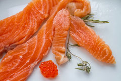 The salty fish (salmon) on the plate. royalty free stock photos