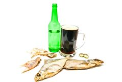 Salty fishes and mug of dark beer Royalty Free Stock Image
