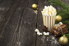 Salty fresh crusty homemade popcorn in silver paper cup in the fashion light background of white brick wall in a New Royalty Free Stock Image