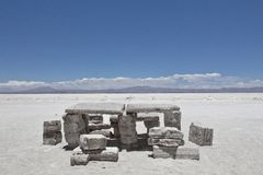 Salty ground and structures. Landscape of the Salar de Uyuni and stock photo