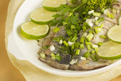 Salty herring. Appetizing snack for a dinner Royalty Free Stock Image