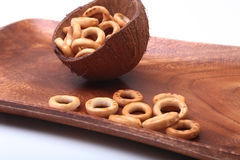 Salty Mini Pretzels with Salt in a Bowl, small bagel - homemade organic snack for beer in wood bowl isolated white Stock Photos