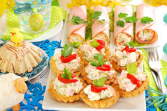 Salty mini tartlets stuffed with vegetable and ham salad Stock Photo