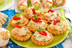 Salty mini tartlets stuffed with vegetable and ham salad Stock Photography