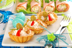 Salty mini tartlets stuffed with walnut cheese and olives Royalty Free Stock Photography