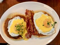 Salty Pancakes with Eggs and Crispy Bacon for Breakfast stock image