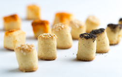 Salty party snacks in a row. royalty free stock photos