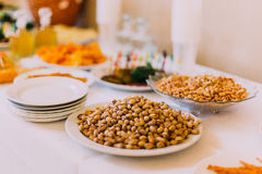 Salty peanuts and pistachios on the luxury served catering table Stock Photo