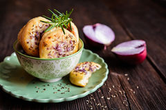 Salty pies with red onion and cumin Royalty Free Stock Image
