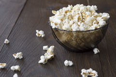 Salty popcorn on the wooden table Royalty Free Stock Photography