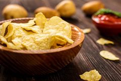 Salty potato chips Royalty Free Stock Images