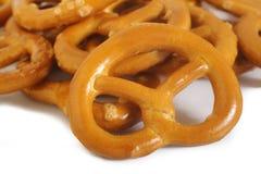 Salty pretzel. On white background Stock Photos