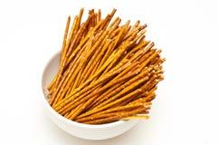 Salty pretzel sticks. Isolated on white background Stock Image