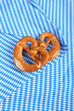 Salty pretzels on checkered fabric Stock Photo