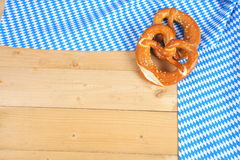 Salty pretzels on wooden board Stock Images