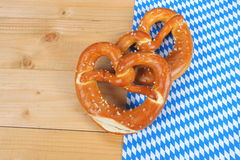 Salty pretzels on wooden board Royalty Free Stock Photo