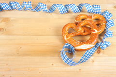 Salty pretzels on wooden board Stock Photography