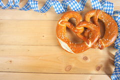Salty pretzels on wooden board Royalty Free Stock Image