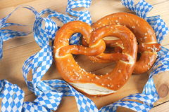 Salty pretzels on wooden board Royalty Free Stock Images
