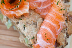 Salty salmon. Salty fish salmon on a bread Stock Photography