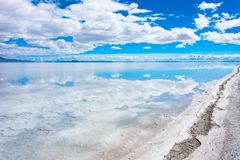 Salty shoreline and flooded salt flats at Bonneville Salt Flats in Utah. Wide angle view of Bonneville Salt Flats in Utah create a mirror reflection scene on the royalty free stock image