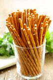 Salty snack bread sticks in a glass Stock Images