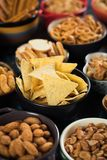 Salty snacks served in bowls Royalty Free Stock Image