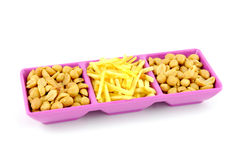 Salty snack in purple bowl Royalty Free Stock Photo