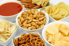 Salty snacks. And salsa dip sauce in white bowls Royalty Free Stock Photos
