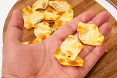 Salty snacks in hand Royalty Free Stock Photo
