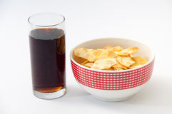 Salty snacks and juice in a glass on a white background Stock Photos