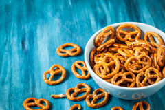 Salty snacks mini pretzels in bowl Stock Images